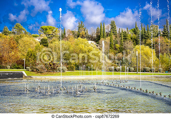 Dancing and singing fountains in the city park in France - csp87672269