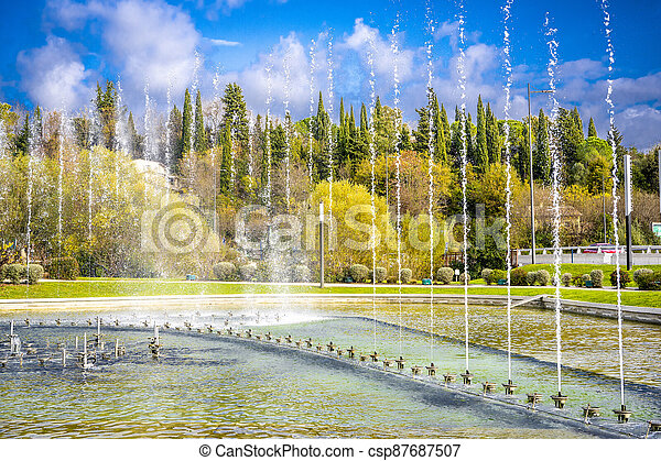 Dancing and singing fountains in the city park in France - csp87687507