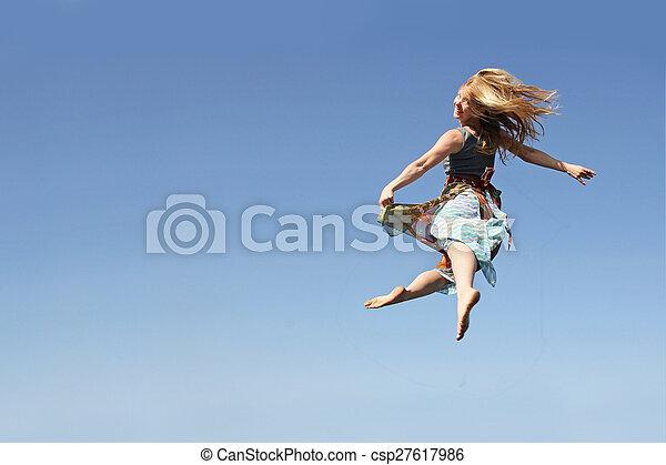 Dancing Woman Leaping through the Air - csp27617986