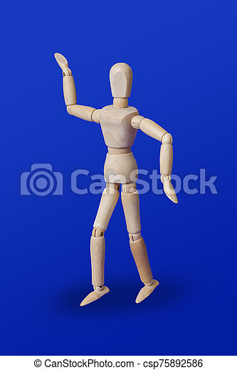 Dancing wooden toy figure on blue - csp75892586
