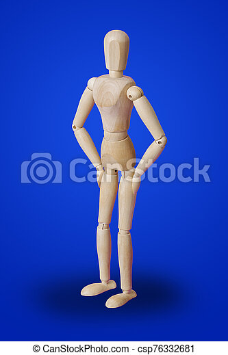 Dancing wooden toy figure on blue - csp76332681