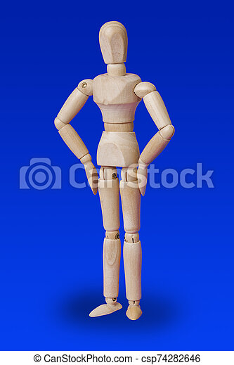 Dancing wooden toy figure on blue - csp74282646