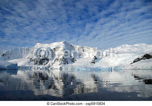 dappled skies over antarctic mountain landscape - csp5915834