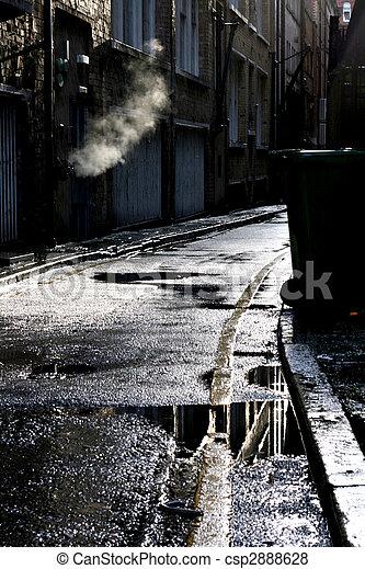 Dark alley in a rain shower - csp2888628