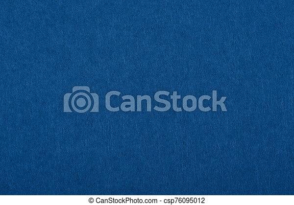 Dark classic blue felt background texture close up - csp76095012