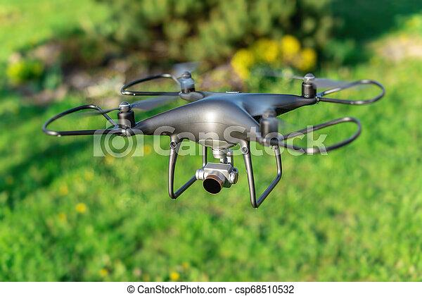 Dark drone flying through the air. - csp68510532