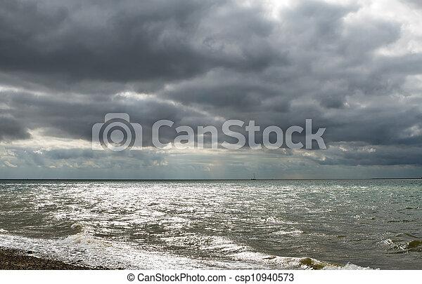 Dark gloomy day on a Uk beach - csp10940573