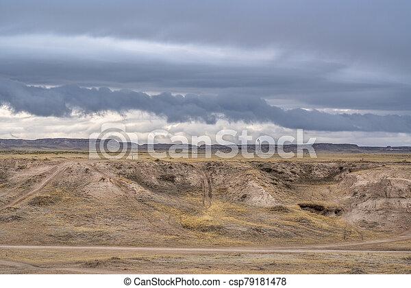 dark stormy clouds over prairie - csp79181478
