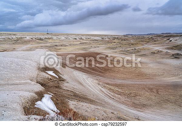 dark stormy clouds over prairie - csp79232597