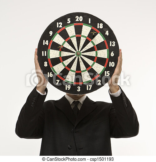 Dartboard in front of face. - csp1501193