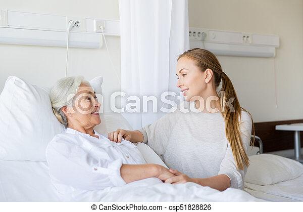 daughter visiting senior mother at hospital - csp51828826