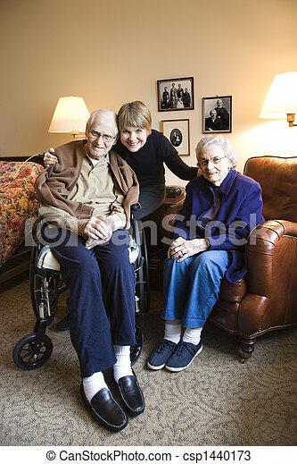 Daughter with elderly parents. - csp1440173