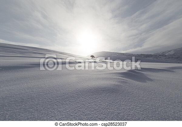 dawn sun in the snowy mountains - csp28523037