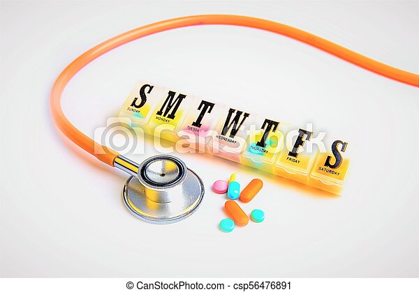 day pill box and capsule and Stethoscope on the white background - csp56476891