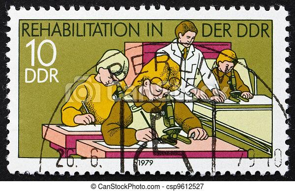 DDR - CIRCA 1979: a stamp printed in DDR shows Hospital Classroom, Rehabilitation in DDR, circa 1979 - csp9612527