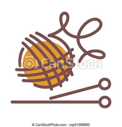 Una bola de hilos de lana y agujas largas para tejer - csp51968863