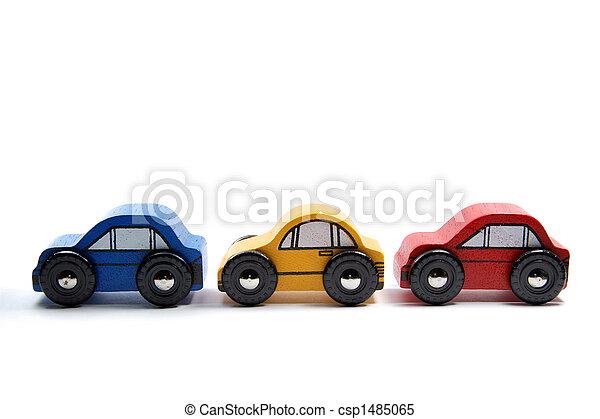 Tres coches de juguete de madera seguidos - csp1485065