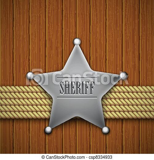 La placa del Sheriff en un fondo de madera. - csp8334933