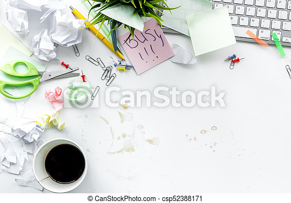 Deadline in office. Sticker Busy on desk covered with crumpled paper and stationery on white background top view copyspace - csp52388171