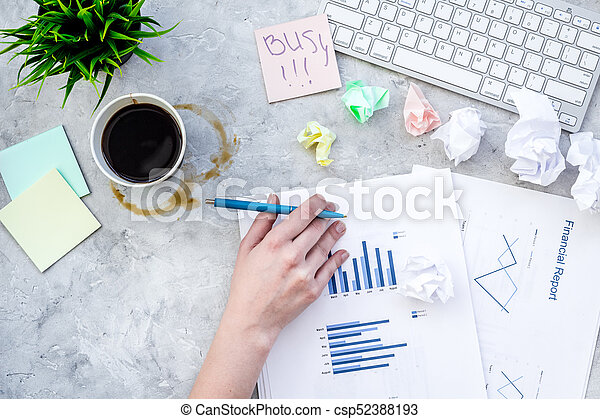 Deadline in office. Sticker Busy on desk covered with crumpled paper and stationery near sheet with chart on grey background top view - csp52388193