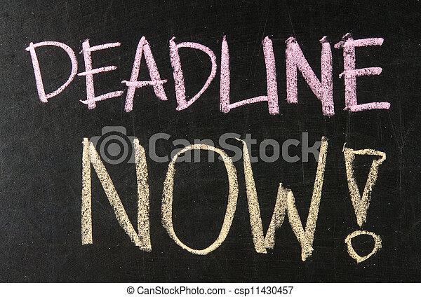 Deadline Now written on a blackboard - csp11430457