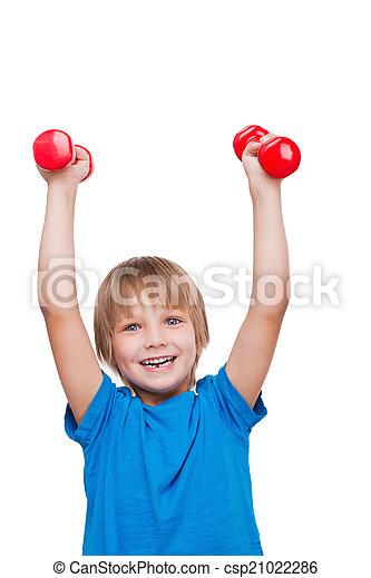 debout, garçon, peu, dumbbells, isolé, exercisme, regarder, quoique, appareil photo, sourire, fort, blanc, man., heureux - csp21022286