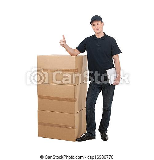 debout, jeune, deliveryman., deliveryman, gai, boîtes, appareil photo, sourire, carton, pile - csp16336770