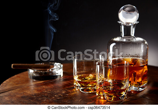 Decanter Of Alcohol By Smoking Cigar On A Table Stock Photo