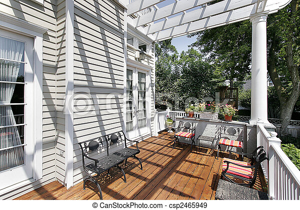 Deck with wrought iron furniture - csp2465949