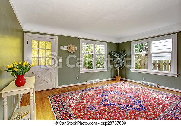 Una sala grande con decoración elegante y paredes verdes. - csp28767809