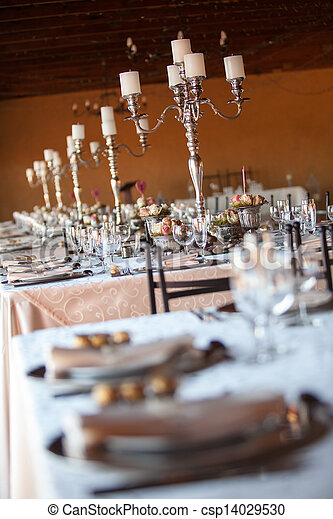 Decorated tables at indoors wedding reception. Selective focus - csp14029530