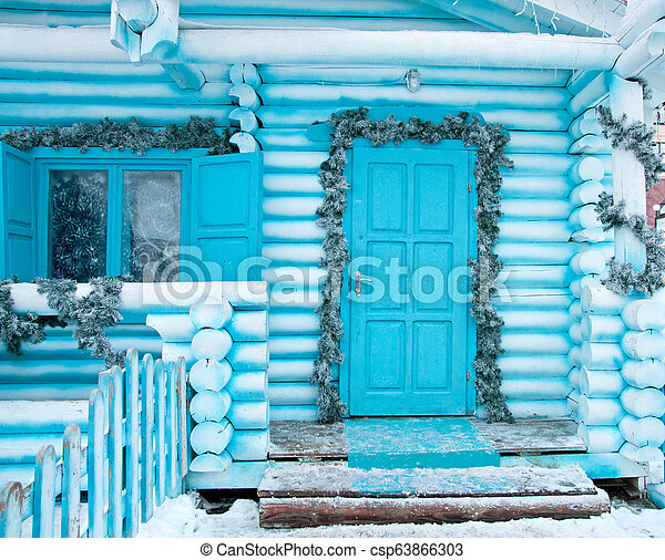 Decorating facade of house for the Christmas Holidays - csp63866303