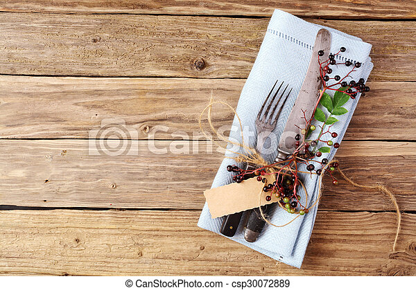 Decorative Autumn Table with cutlery and napkin - csp30072889