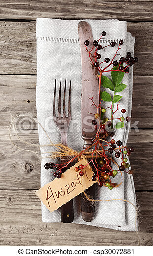 Decorative Autumn Table with vintage silverware and napkin - csp30072881