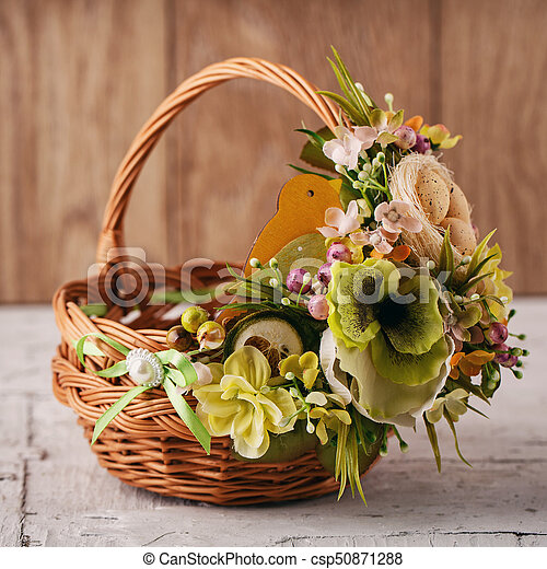 Decorative basket decorated with flowers - csp50871288