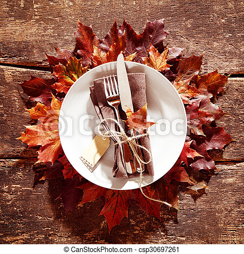 Decorative colorful autumn table setting - csp30697261
