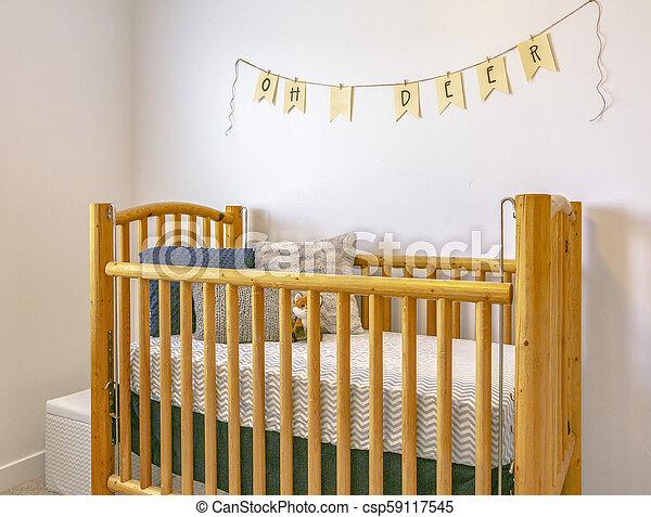 Decorative crib in model home - csp59117545