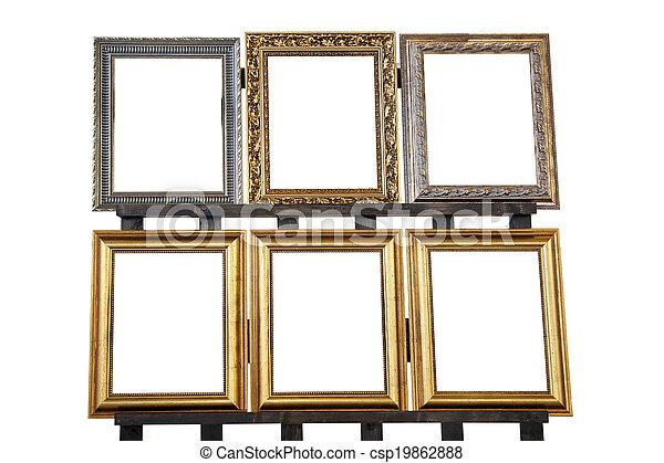 Decorative frames. Decorative retro vintage frames on wooden pedestal.