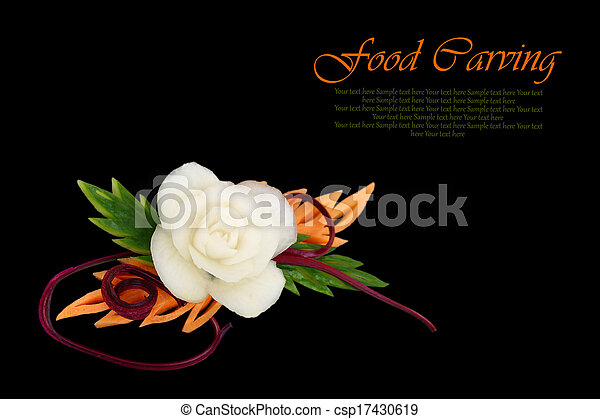 Decorative white flower carved from vegetable on black background - csp17430619