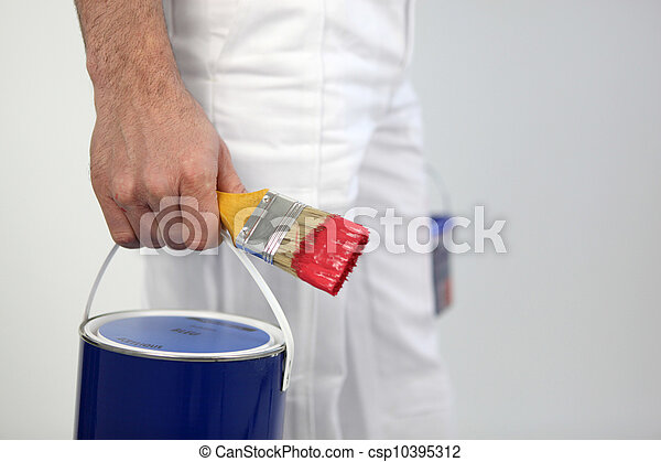 Decorator holding paint and paint brush - csp10395312