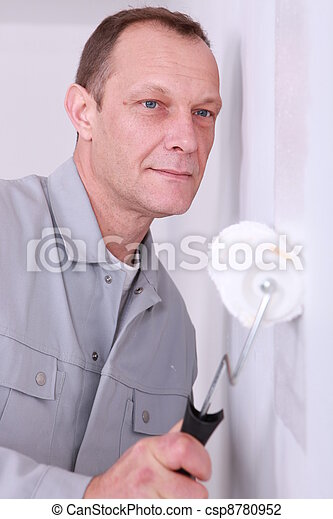 Decorator painting a room white - csp8780952