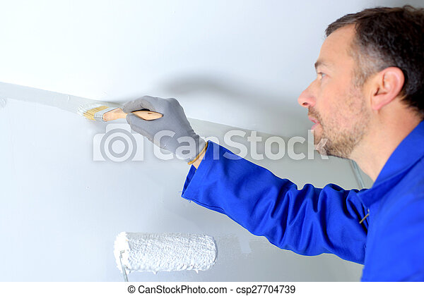 Decorator painting a wall - csp27704739