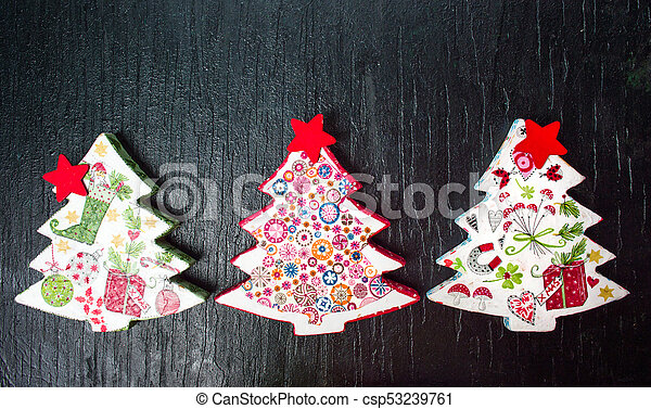 Decoupage Christmas tree decoration on black