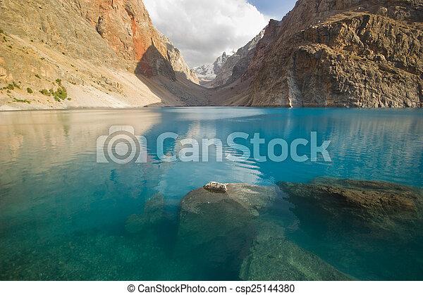 deep blue mountain lake - csp25144380