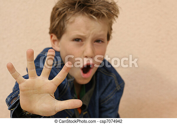 defiant or abused boy angry or frightened hand out  - csp7074942