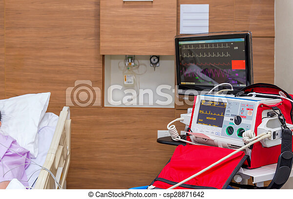 Defibrillator in ICU room at hospital with medical equipments - csp28871642