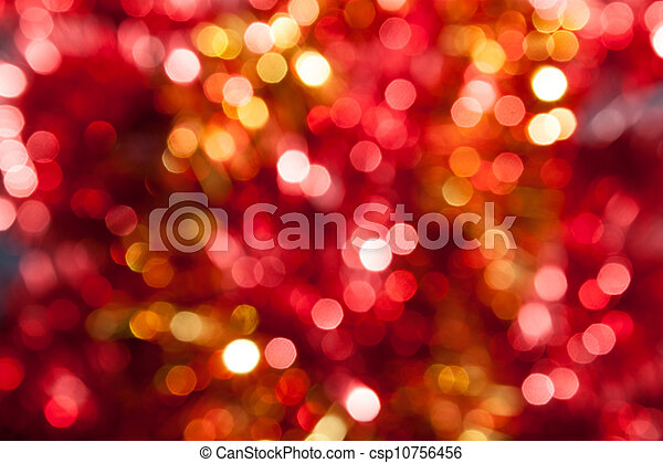 Defocused abstract red and yellow christmas background - csp10756456