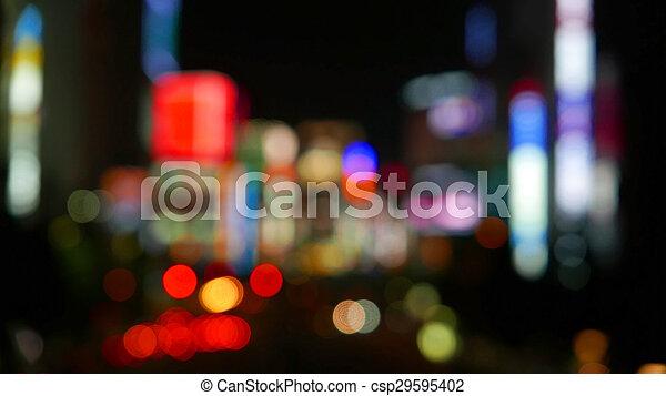 Defocused city night bokeh background - csp29595402