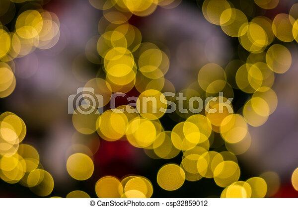 Defocused ligths of golden Christmas tree - csp32859012