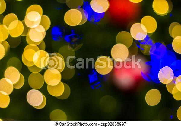 Defocused ligths of golden Christmas tree - csp32858997
